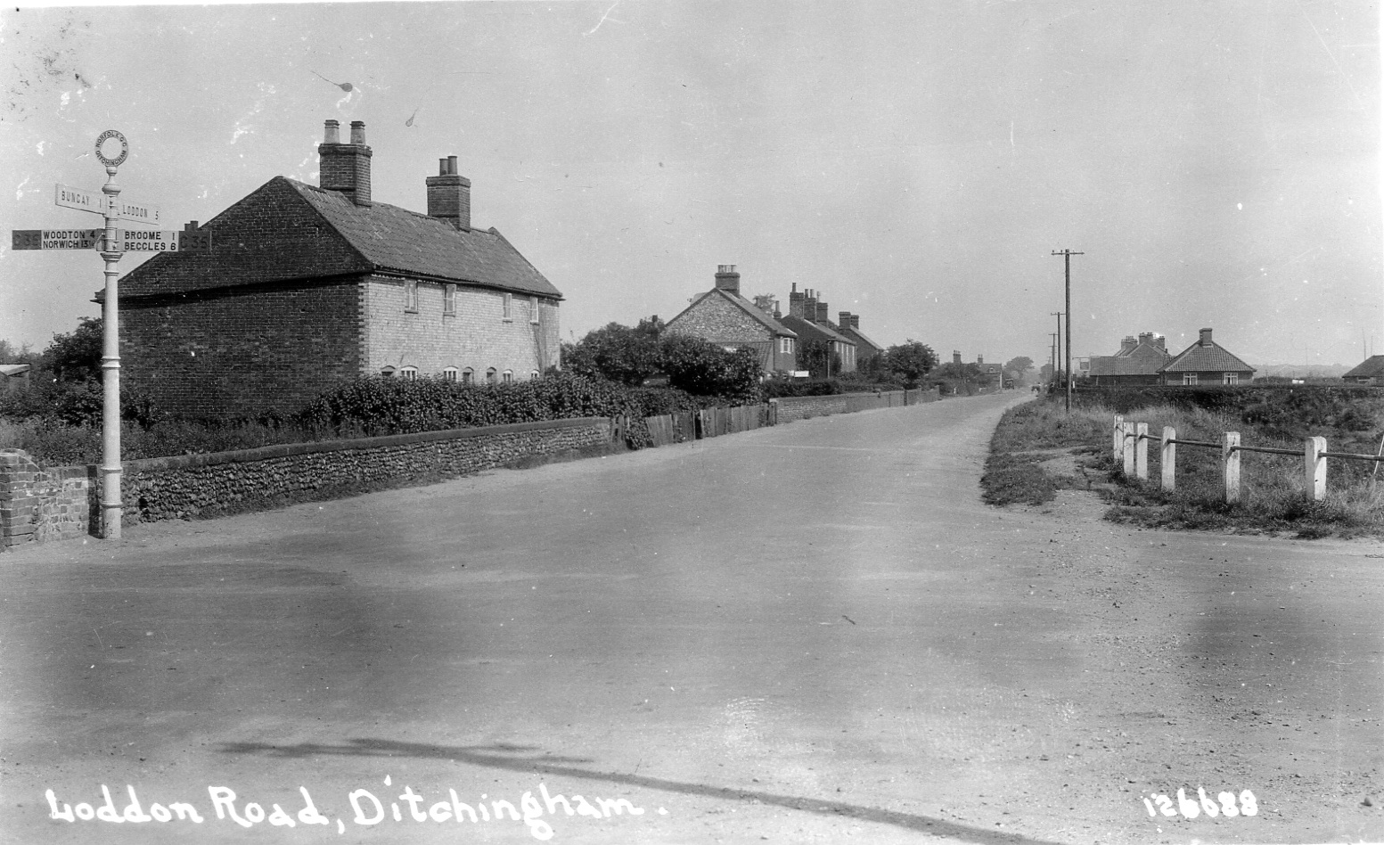Ditchingham crossroads looking towards Loddon - the village shop is now on the left past these cottages.